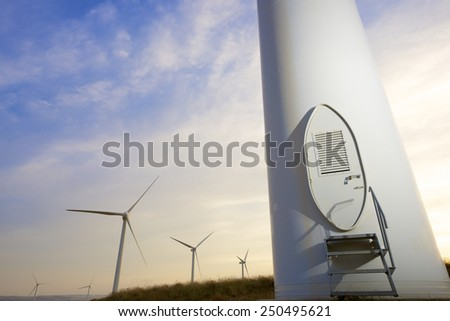 Windmills for electric power production at sunset, Pozuelo de Aragon, Zaragoza, Aragon, Spain - stock photo