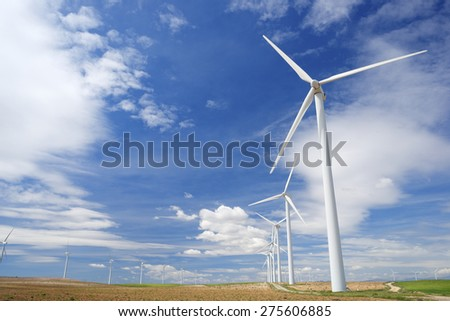 Windmills for electric power production, Pozuelo de Aragon, Zaragoza, Aragon, Spain. - stock photo