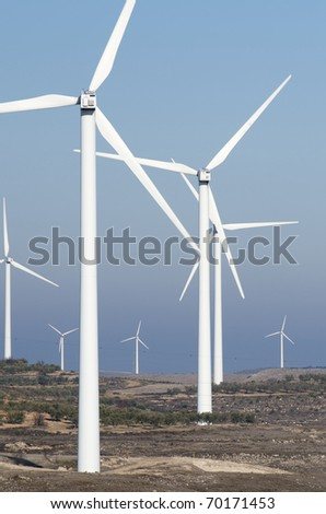 windmills for electricity production with blue sky - stock photo