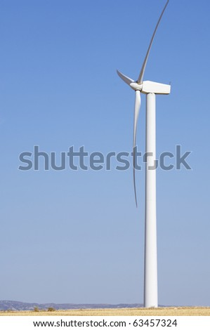 windmills for renewable electric energy production and clear sky - stock photo