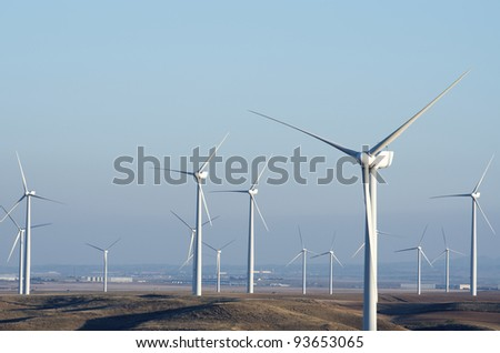 windmills for renowable electric production with clear sky - stock photo