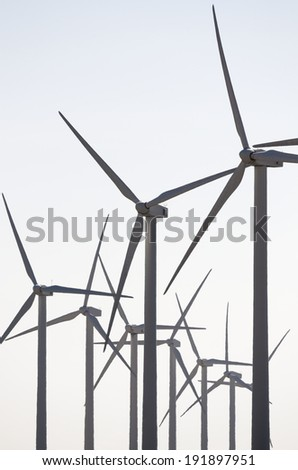 Windmills for renowable electric production with white sky, Zaragoza province, Aragon, Spain - stock photo