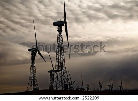 Windmills generating electricity. - stock photo