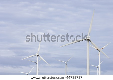 windmills group and cloudy sky