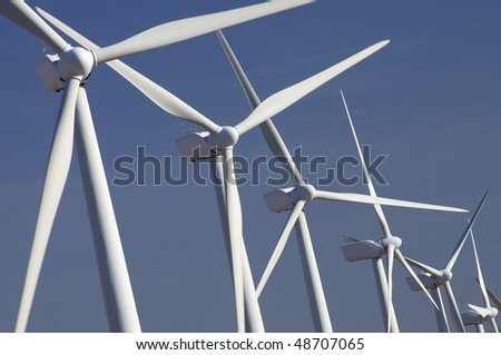 windmills group with blue sky - stock photo