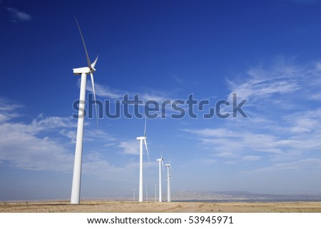 windmills group with cloudy and blue sky