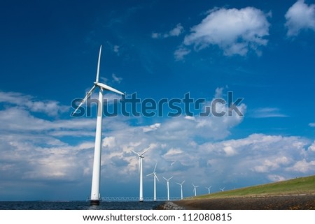 Windmills in a row - stock photo