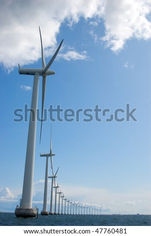 Windmills in a row on sunny weather, vertical, oresund, denmark, baltic sea - stock photo
