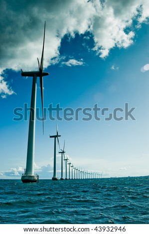 Windmills in a row vertical - stock photo