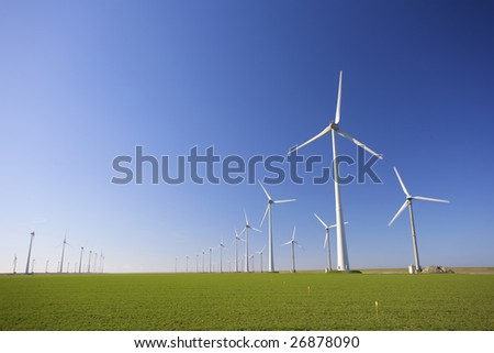Windmills in Holland producing clean energy to help against global warming - stock photo