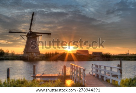 Windmills in Kinderdijk, Netherlands in morning sun - stock photo