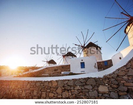 Windmills in Mykonos, early morning sunrise. - stock photo