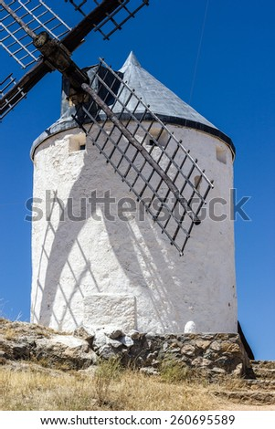 Windmills in Spain, La Mancha, famous Don Quijote location. Clear blue sky - stock photo