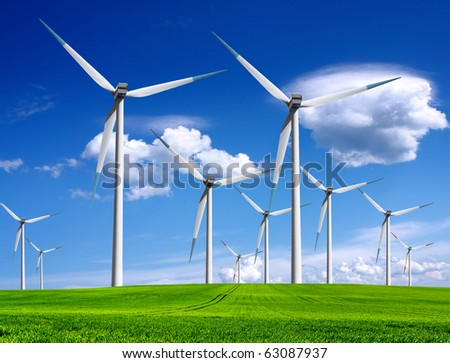 Windmills in summer landscape - stock photo