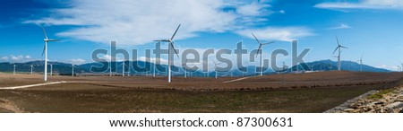 Windmills in summer landscape of Andalucia, Spain, Europe - stock photo