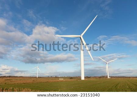 Windmills in the Danish Marsh Near Esbjerg, Denmark is a very big windmill farm. - stock photo