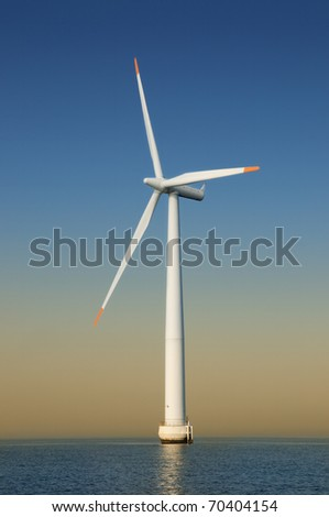 Windmills in the sea - stock photo