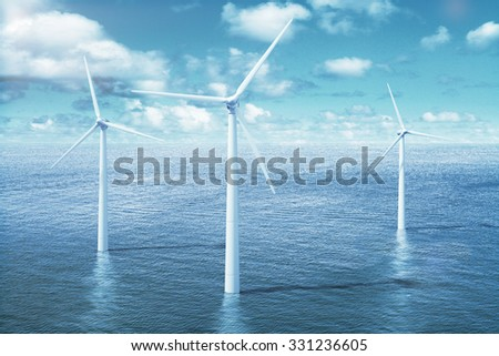 Windmills in the water with cloudy sky  - stock photo
