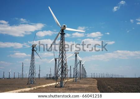 Windmills in wind-farm - stock photo