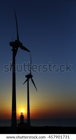 Windmills & Lighthouse Silhouettes At Sunset