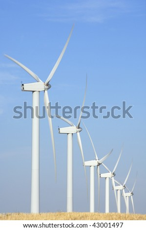 windmills lined with clear sky