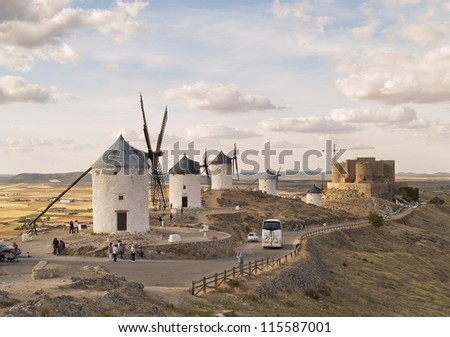 Windmills located in Consuegra, Toledo, Spain. Windmills became famous in the 16th century, when Don Quixote was first published. Castle at background. - stock photo