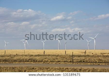 Windmills on a desert landscape - stock photo