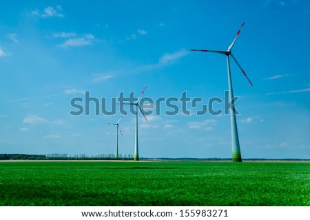 Windmills on a green field