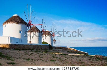 Windmills on a hill near the sea on the island of Mykonos - stock photo