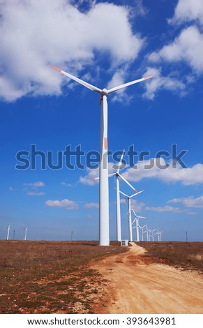 Windmills on blue sky background
