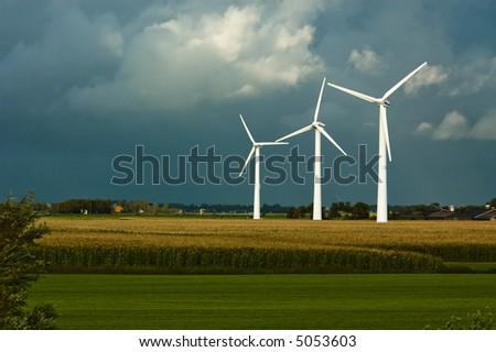 windmills on farmland - stock photo