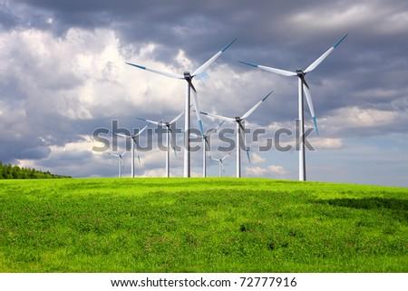 Windmills on summer field - stock photo