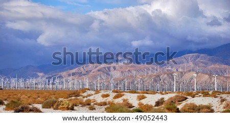 Windmills rotating and producing clean energy, electric power. - stock photo