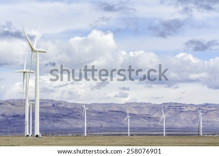 Windmills spinning in the wind - stock photo