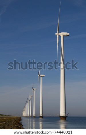 Windmills standing in the water - stock photo