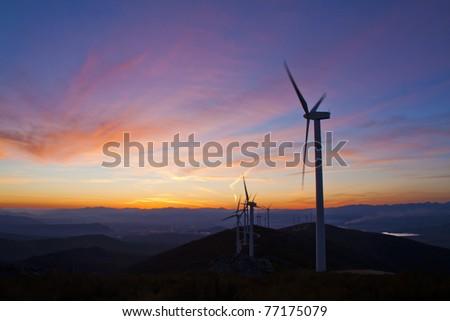 windmills sun set - stock photo