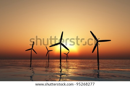 Windmills with a bright sunset