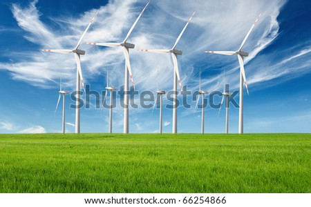 windmills with fresh green grass and beautiful blue sky - stock photo