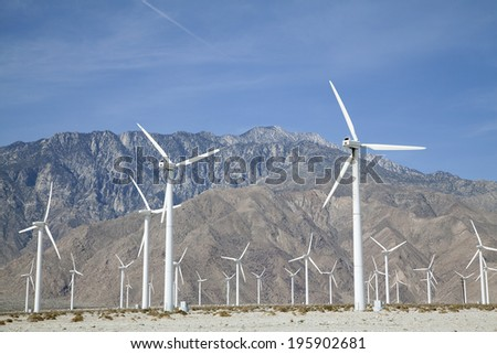 Windmills with mountain in background, near Palm Springs CA - stock photo