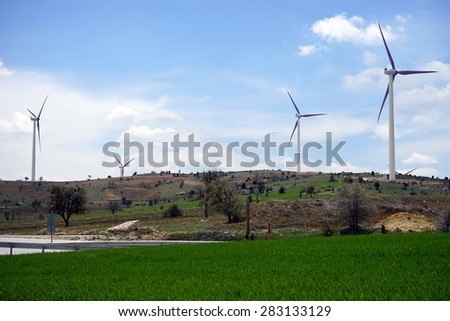 windmils on background blue sky and green grass