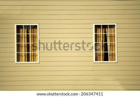 Window against vinyl siding at a local community - stock photo