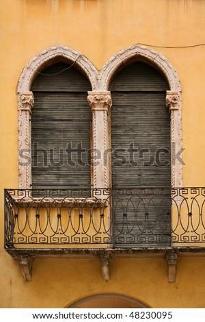 Window and door with balcony in venetian style on Verona street, Italy - stock photo