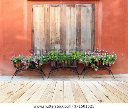 Window and flower pot - stock photo