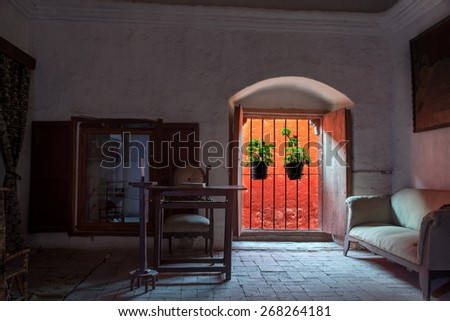 Window and flowers in Santa Catalina Monastery in Arequipa, Peru - stock photo