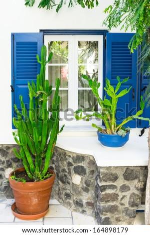 window and garden pots - stock photo