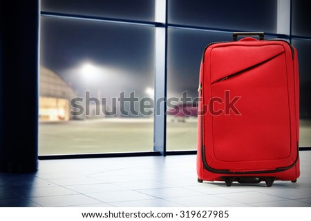 window and red suitcase  - stock photo