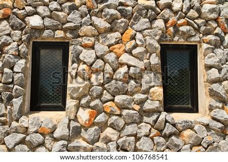 window and rock wall - stock photo