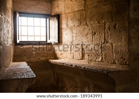Window and two seats in medieval crusader's castle - stock photo