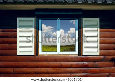 window and type in the meadow - stock photo