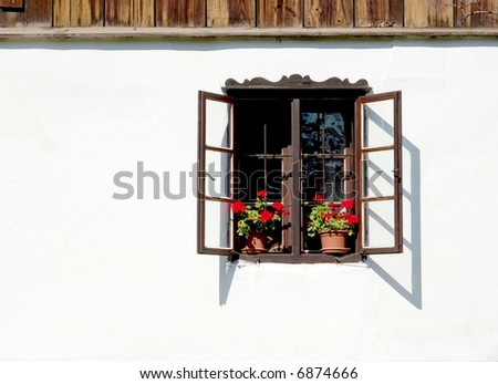 Window and white wall of an old rural house